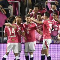 Cerezo Osaka defender Osmar (43) is congratulated by teammates after scoring a tying goal in the 78th minute against visiting Jubilo Iwata on Friday night. The teams settled for a 1-1 draw. | KYODO