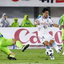 Frontale's Akihiro Ienaga (center) takes a shot during the first half against Bellmare on Wednesday in Hiratsuka, Kanagawa Prefecture.