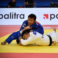 Naohisa Takato defends under-60 kg title at world championships