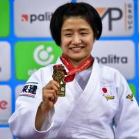Tsukasa Yoshida poses with her gold medal during the medal ceremony for the under-57 kg women category of the 2018 Judo World Championships in Baku on Saturday. | AFP-JIJI