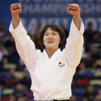 Chizuru Arai reacts after defending her title in the women's 70-kg division at the world championships with a victory over France's Marie Eve Gahie in Baku on Monday. | KYODO