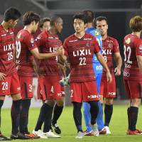 Kashima Antlers players gather after their 1-1 draw against Kawasaki Frontale in the first leg of the Levain Cup quarterfinals at Kashima Stadium on Wednesday night. | KYODO