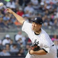 Yankees' Tanaka tames Tigers to earn first win since July 31