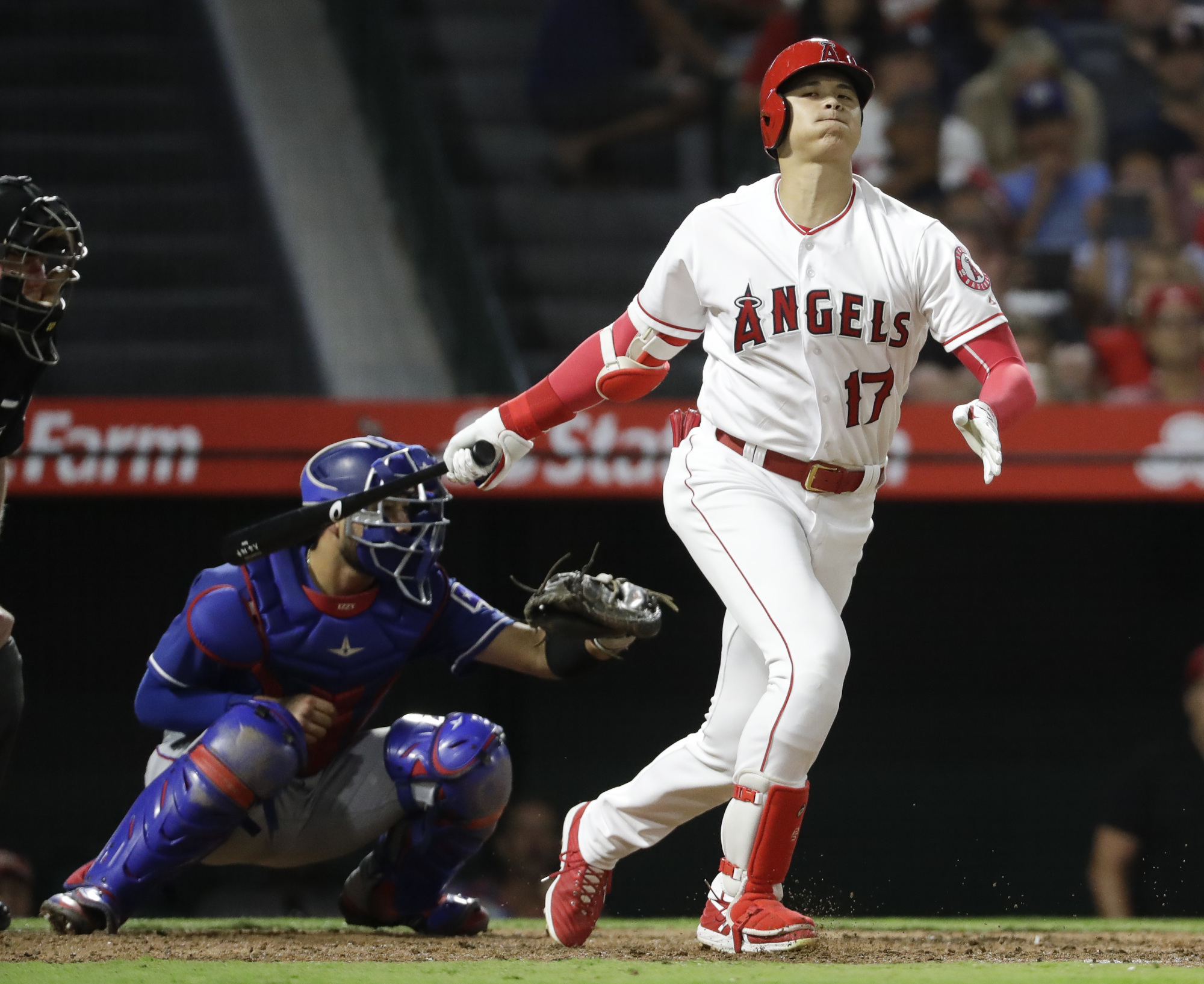 The Angels' Shohei Ohtani strikes out during the fourth inning against the Rangers on Tuesday. | AP