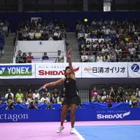 Naomi Osaka serves during her match at the Toray Pan Pacific Open on Wednesday. | AP