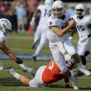 Old Dominion quarterback Blake LaRussa avoids a sack during his team's game against Virginia Tech on Saturday.