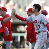 Shohei Ohtani celebrates with Angels manager Mike Scioscia following the team's 1-0 win over the White Sox on Sunday in Chicago | KYODO