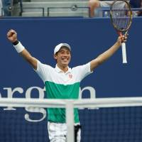 Kei Nishikori celebrates his five-set victory over Marin Cilic in their quarterfinal match at the U.S. Open on Wednesday. | AFP-JIJI