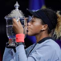 Naomi Osaka of Japan kisses the U.S. Open trophy after beating Serena Williams of the U.S. in the womenís final on day 13 of the 2018 U.S. Open tennis tournament at USTA Billie Jean King National Tennis Center.  | ROBERT DEUTSCH/USA TODAY SPORTS/VIA REUTERS