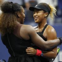 Naomi Osaka hugs Serena Williams after their historic match at the USTA Billie Jean King National Tennis Center.    GEOFF BURKE/USA TODAY SPORTS/VIA REUTERS