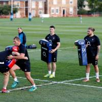 The England rugby national team, seen training on Monday in Bristol, England, will be based in Miyazaki to prepare for the 2019 Rugby World Cup. | REUTERS