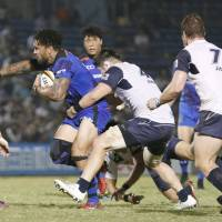 Panasonic's Digby Ioane carries the ball against Yamaha in a Japan Rugby Top League match on Saturday at Prince Chichibu Memorial Rugby Ground. The Wild Knights beat Jubilo 15-0. | KYODO