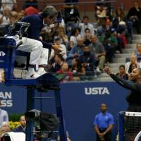 Serena Williams of the U.S. argues Saturday with chair umpire Carlos Ramos while playing Naomi Osaka of Japan during their 2018 US Open women's singles final match in New York. Serena Williams has been fined $17,000 by the U.S. Tennis Association in the wake her outburst during a controversial U.S. Open final loss to Osaka. | AFP-JIJI
