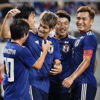 Sho Sasaki (center) celebrates with teammates after participating in Japan's opening goal against Costa Rica in an international friendly on Tuesday in Suita, Osaka Prefecture. | KYODO