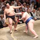 Kisenosato (left) is forced out of the dohyo by sekiwake Ichinojo on Wednesday during the 11th day of the Autumn Grand Sumo Tournament. It was the yokozuna's third defeat.