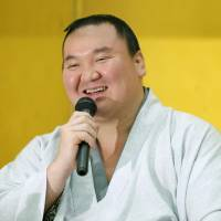 Yokozuna Hakuho speaks during a news conference on Monday, the day  after he finished the Autumn Grand Sumo Tournament with a 15-0 record. | KYODO