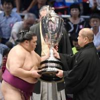 The 30-kg Emperor's Cup is awarded to the winner of each sumo tournament. | KYODO