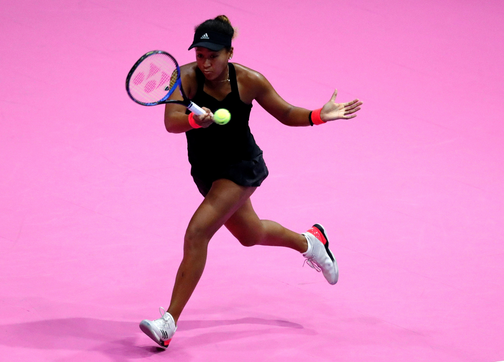 Naomi Osaka plays a shot from Camila Giorgi in their semifinal match at the Toray Pan Pacific Open on Saturday. | REUTERS