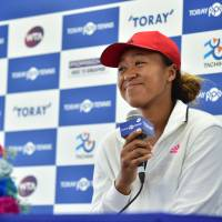 U.S. Open women's champion Naomi Osaka smiles at a Pan Pacific Open news conference on Monday. | AFP-JIJI