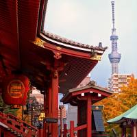 Sensoji Temple in Asakusa with Tokyo Skytree in the distance. The temple's Kaminarimon Gate is famous for its gigantic red lantern. | GETTY IMAGES