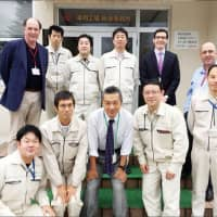 Rennicks Group Managing Director Michael Flanagan (standing, far left), Group Technical Manager Sean Coffey and Commercial Manager Cathal D'Arcy with the Nippon Carbide Industries team led by Group Sales Manager Hiroshi Ata and Optical Products Development Division Manager Takeo Takamatsu
