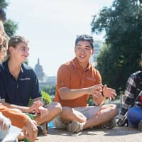 Students interact on campus at the university's iconic South Mall. | UT-AUSTIN