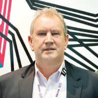 Michael Finn, Managing Director of Nitto Denko (Australia) Pty Ltd. Background art using Nitto's Haru stuck-on design PET tape