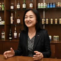 Suntory Holdings Ltd. Executive Officer Tomomi Fukumoto explains the firm's environmental efforts in an interview with The Japan Times in Tokyo on Sept. 11. | YOSHIAKI MIURA