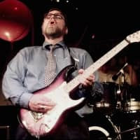 Microsoft co-founder and billionaire Paul Allen joins in with the band and plays electric guitar at an election night victory party in the early morning hours in Seattle in 1997. Allen, billionaire owner of the Portland Trail Blazers and the Seattle Seahawks and Microsoft co-founder, died Monday at age 65.   AP