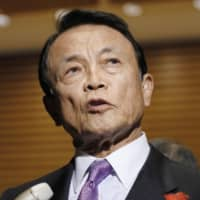 Finance chiefs should handle currency issues, Taro Aso says after U.S. push to prevent devaluations