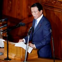 Finance Minister Taro Aso delivers his policy speech at the Diet on Wednesday. | REUTERS