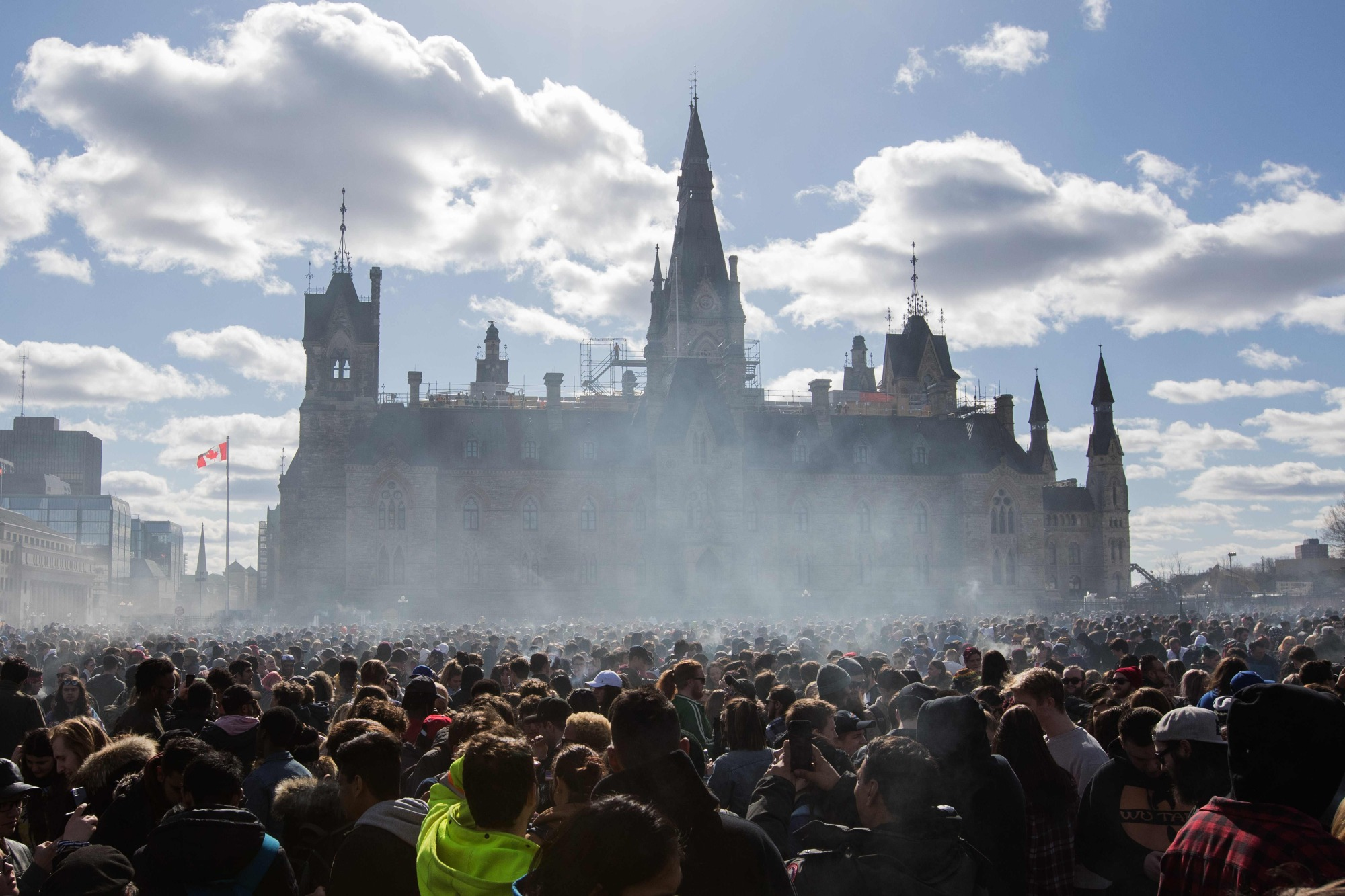 Smoke lingers over Parliament Hill as people smoke marijuana during the annual 4/20 rally on Parliament Hill in Ottawa in April. Canada's top medical journal warned on Monday that the imminent legalization of cannabis for recreation use poses a major health concern despite broad support for ending the prohibition. Diane Kelsall, editor in chief of the Canadian Medical Association Journal, called the Wednesday launch 'a national, uncontrolled experiment in which the profits of cannabis producers and tax revenues are squarely pitched against the health of Canadians.' | AFP-JIJI