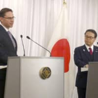 Jyrki Katainen, vice president of the European Commission in charge of jobs, growth and investment, speaks at a joint news conference with trade minister Hiroshige Seko (center) and Foreign Minister Taro Kono on Monday in Tokyo following their talks on free trade. | KYODO