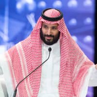 Saudi Crown Prince Mohammed bin Salman speaks during the Future Investment Initiative Forum in Riyadh Wednesday. | BANDAR ALGALOUD / COURTESY OF SAUDI ROYAL COURT / HANDOUT / VIA REUTERS