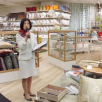 Kumiko Otsuka, president of Otsuka Kagu Ltd., speaks to reporters at one of its furniture and interior outlets in Tokyo in 2016. Jumpei Kitahara, a top-performing fund manager, invests only in owner-managed and family-run firms such as Otsuka Kagu. | KYODO