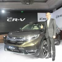 Gaku Nakanishi, president and CEO of Honda Cars India Ltd., says the firm will continue betting on its hybrid series in India. | NNA/KYODO