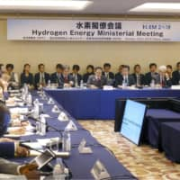 Ministers and other officials from around 20 nations hold the Hydrogen Energy Ministerial Meeting in Tokyo on Tuesday. | KYODO