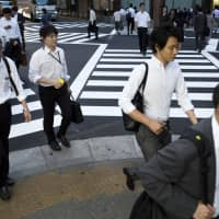 There were 1.64 openings for every job-seeker in September, the highest level since January 1974 and up from 1.63 the previous month, according to the labor ministry. | BLOOMBERG