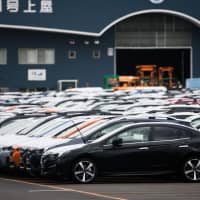 Analysts think the possibility of higher U.S. tariffs on Japanese car exports has eased, according to a recent survey. | BLOOMBERG