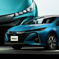 A Toyota Prius plug-in hybrid is shown to the media at a news conference in February 2017. Toyota Motor Corp. said Friday it is recalling more than 2.4 million hybrid cars. | AFP-JIJI