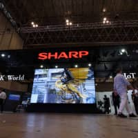 Sharp Corp. slashed its sales outlook for the current business year partly due to a decline in television sales in China. | BLOOMBERG