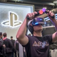 Record sales of popular PS4 titles and growth in Sony's PlayStation division are said to be behind the firm's earnings upgrade. | BLOOMBERG