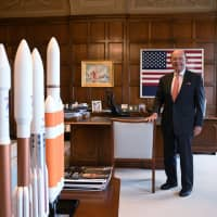 U.S. Secretary of Commerce Wilbur Ross poses near rocket models during an interview in his office at the U.S. Department of Commerce building in Washington on Friday. | REUTERS
