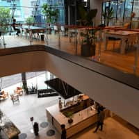 The Iceberg's large windows allow for plenty of sunlight, and like many other WeWork spaces, it features a pantry and bar counter. | YOSHIAKI MIURA