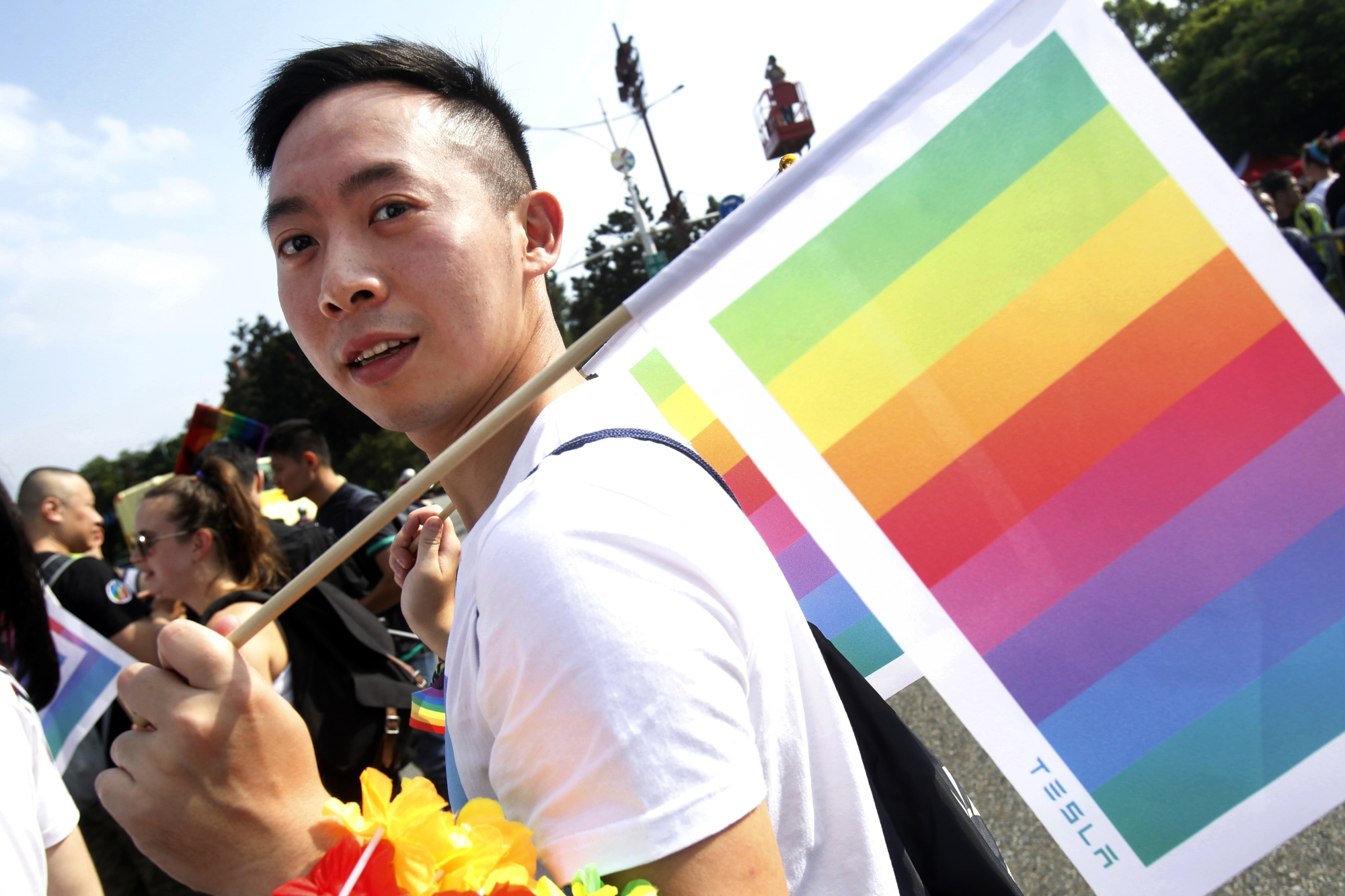 A participant carries a rainbow flag during the annual gay and lesbian parade, organized by Taiwan LGBT Pride, in Taipei on Saturday. | AP