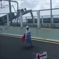 Damage is seen on the bridge linking Kansai airport to Osaka in this still from a video posted to Twitter. | REUTERS
