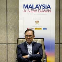 Anwar Ibrahim waits to speak Tuesday at the New Dawn Investors' Conference in Kuala Lumpur. | BLOOMBERG