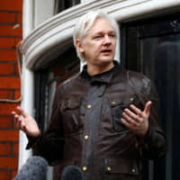 WikiLeaks founder Julian Assange at the Ecuadorian Embassy in London in 2017 | REUTERS