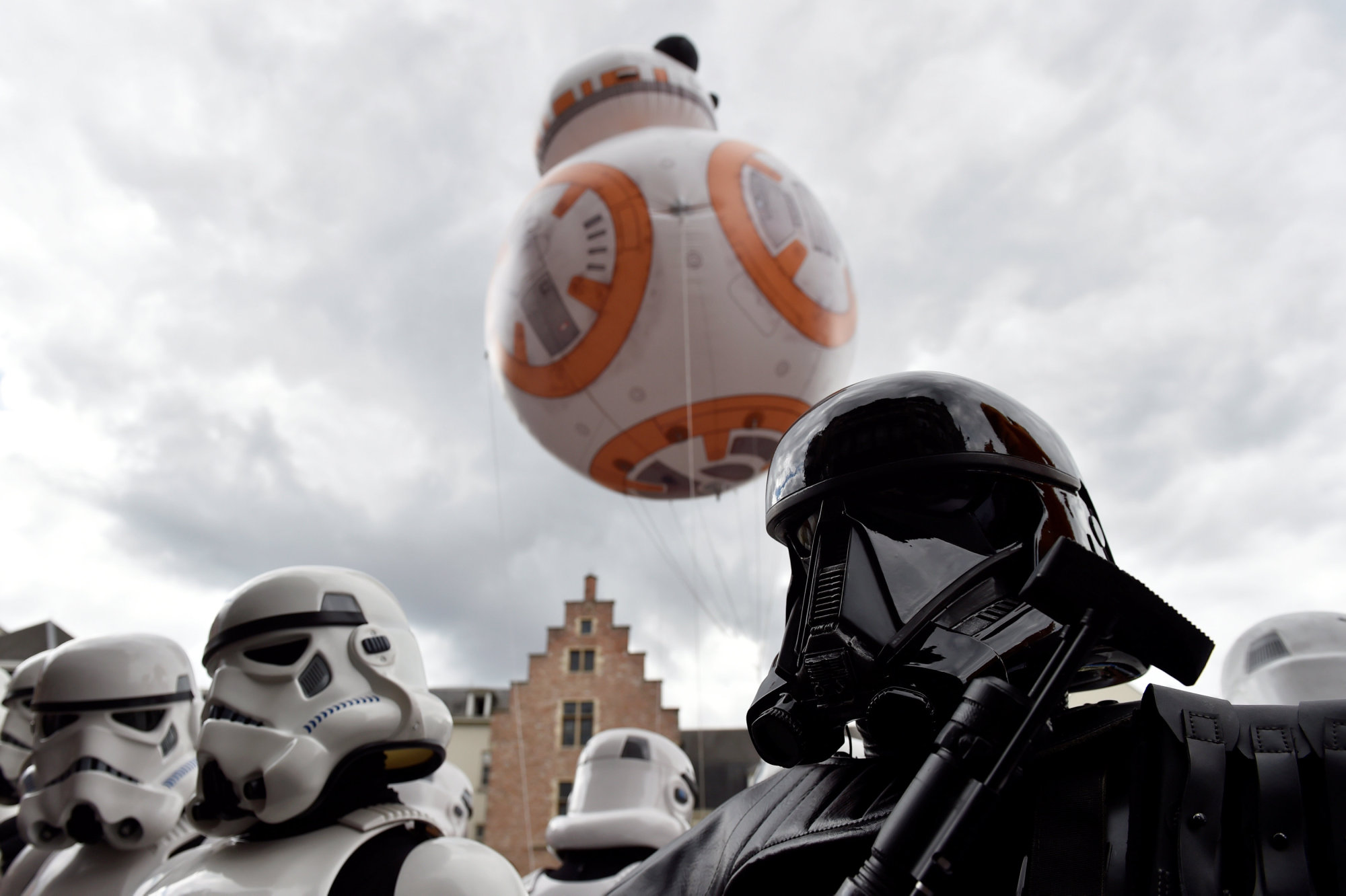 A giant balloon of BB-8 floats behind participants wearing Star Wars costumes during the Balloon Day Parade as part of the Comic Strip Festival in Brussels in September. | REUTERS
