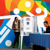 Brazilians cast their votes in the nation's presidential election in Curitiba on Sunday. | REUTERS